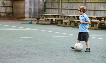 Primary_child_playing_football